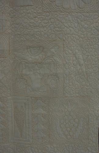 Detail of various styles of fillers on reverse of Halloween block quilt