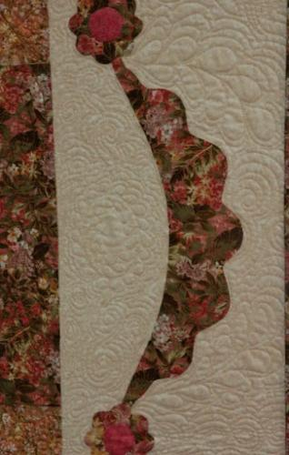 This photo shows part of the freehand quilting in the outer border of Wentworth to Baltimore