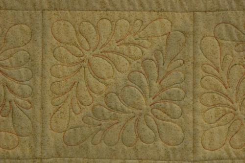 Here is a close-up of one of the blocks showcasing the variegated King Tut thread Autumn Days