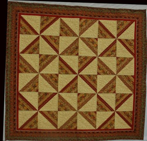 Another lovely quilt by Audrey Woods with a feathered block design by Keryn Emerson