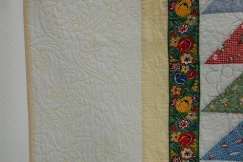 Detail of the border quilting designs on North for the Summer