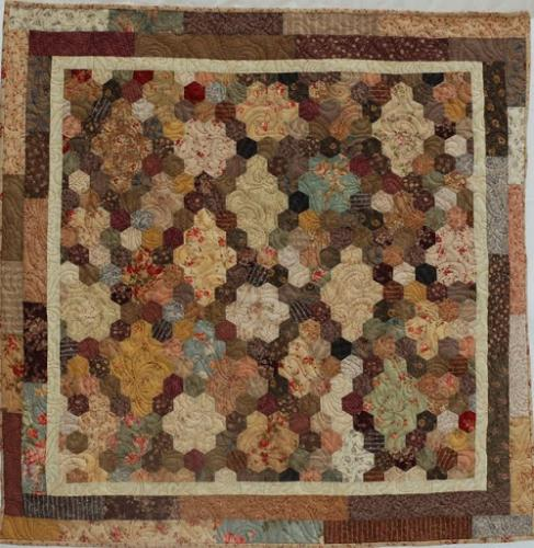 A lovely hexagon quilt in Japanese floral fabrics. It is quilted in a beautiful design by Jodie Beamish called Chrissy