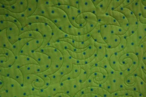 This is a detail of the Star Swirl quilting on Lisa's New York Beauty