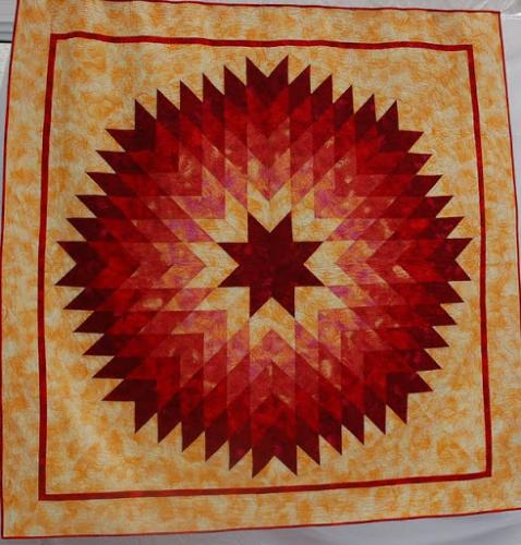 This visually stunning quilt by Audrey Woods is called Giant Dahlia and is quilted edge to edge with a design by Keryn Emerson called Petaluma