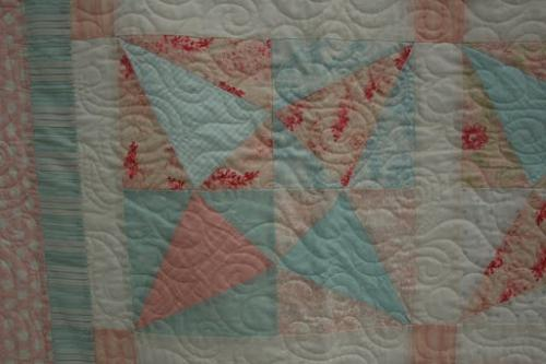 Detail of Rhapsody worked as a pantograph design in the centre of the quilt