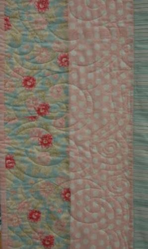 Detail of Asian Clouds worked as a single row border design on Crossed Canoes by Lisa Price