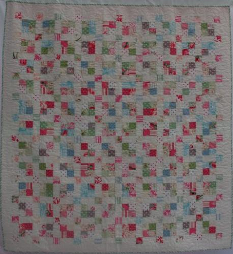 Sashed 4-patch by Lisa Price and quilted isong the pattern Fancy That by Jodie Beamish
