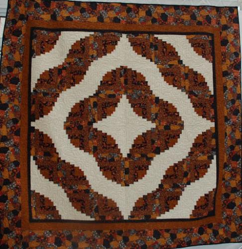 Curved Log Cabin quilt by Audrey Woods