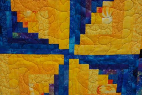 This is a detail of the centre of Audrey Woods Escaping Ribbons log cabin quilt