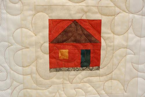 Detail of one of the log cabin centres on Audrey Woods quilt