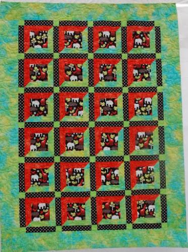 Cot quilt by sara Coxon