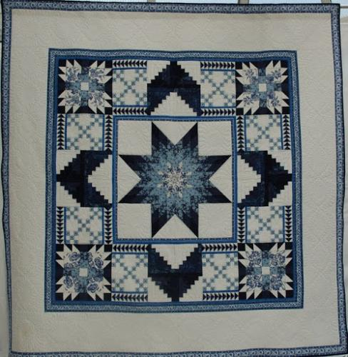 This quilt was pieced by Paula Doyle of Green Mountain Quilts and quilted by Isabel Hall of Compton Quilting Services.The quilting is all freehand and the quilt won first prize for longarm quilting in the Great Northern Quilt Show in 2005.