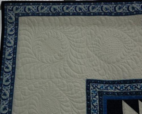 Detail of the freehand corner quilting on Willow Star