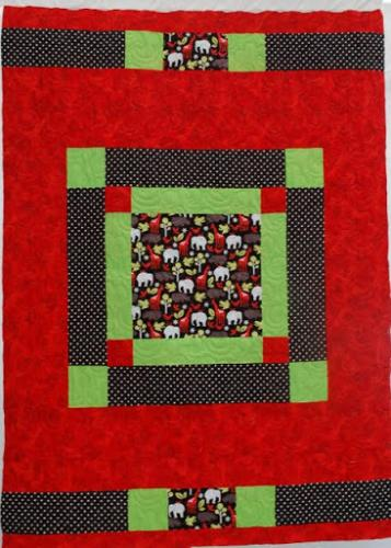 A reverse view of a child's cot quiilt by Sara Coxon -the quilting pattern is Popcorn